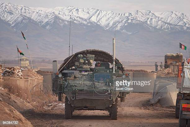 Jeremy Ellis from Ashland Kentucky of the US Army's Alpha Company 4th Battalion 5th Stryker Brigade looks out from the top of a Stryker armored...
