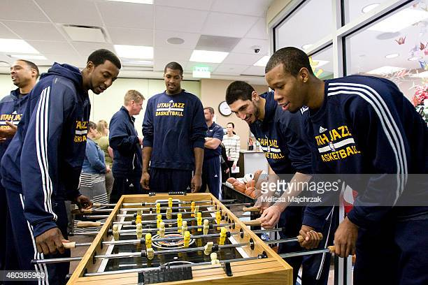 Jeremy Evans Derek Favors 15 Enes Kanter and Rodney Hood of the Utah Jazz play foosball prior to visiting kids at Primary Children's Hospital at...