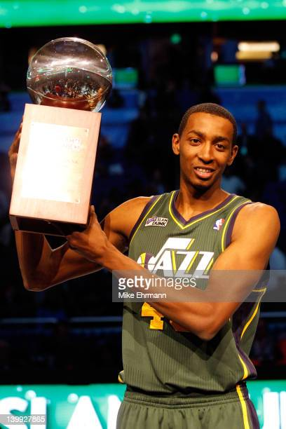 Jeremy Evans of the UTah Jazz celebrates with his trophy after he won the Sprite Slam Dunk Contest part of 2012 NBA AllStar Weekend at Amway Center...
