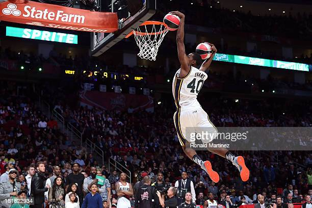 Jeremy Evans of the Utah Jazz dunks two basketballs in the second round during the Sprite Slam Dunk Contest part of 2013 NBA AllStar Weekend at the...