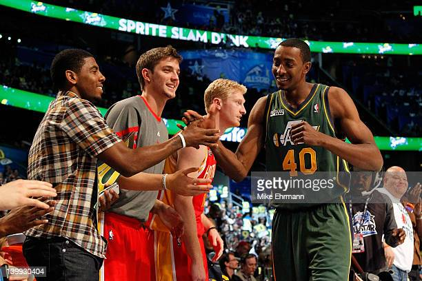 Jeremy Evans of the Utah Jazz is congrated by Kyrie Irving of the Cleveland Cavaliers Chandler Parsons and Chase Budinger of the Houston Rockets...
