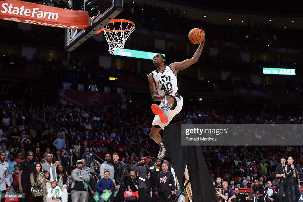 Jeremy Evans of the Utah Jazz jumps over a painting of himself in the final round during the Sprite Slam Dunk Contest part of 2013 NBA All-Star Weekend at the Toyota Center on February 16, 2013 in Houston, Texas.