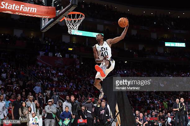 Jeremy Evans of the Utah Jazz jumps over a painting of himself in the final round during the Sprite Slam Dunk Contest part of 2013 NBA AllStar...