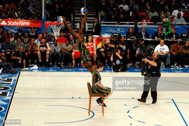 Jeremy Evans of the UTah Jazz jumps over jumps over teammate Gordon Haywood as he dunks two basketballs during the Sprite Slam Dunk Contest part of...