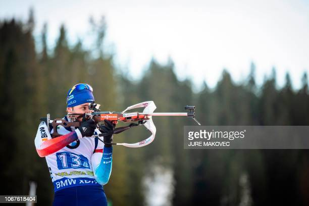 Jeremy Finello of Switzerland competes at the shooting range during the Mixed Relay competition of the IBU Biathlon World Cup in Pokljuka in the...