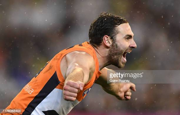 Jeremy Finlayson of the Giants celebrates kicking a goal during the AFL Preliminary Final match between the Collingwood Magpies and the Greater...
