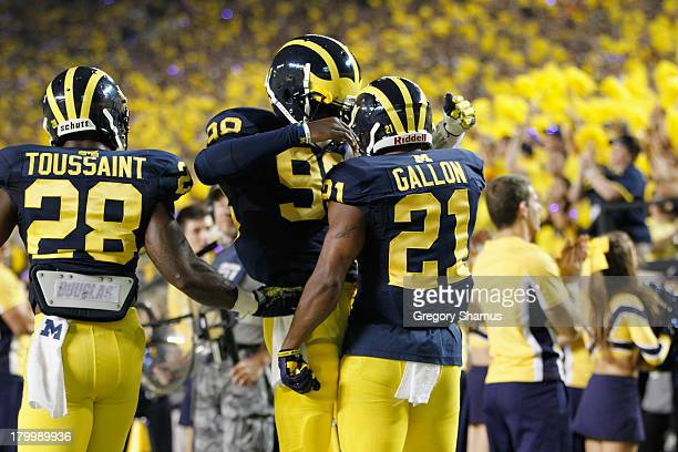 Jeremy Gallon of the Michigan Wolverines celebrates a first quarter touchdown with and Devin Gardner against the Notre Dame Fighting Irish during the...