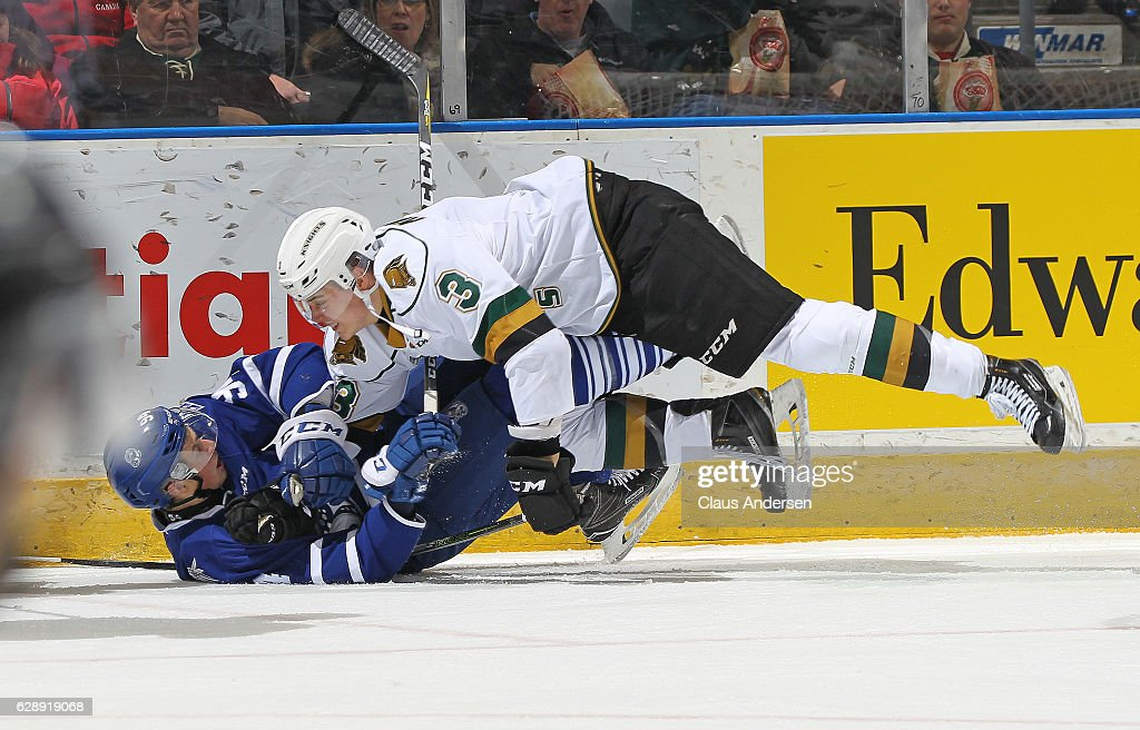 Jeremy Goodwin #94 of the Mississauga Steelheads gets crushed by Nicolas Mattinen #3 of the London Knights during an OHL game at Budweiser Gardens on December 9, 2016 in London, Ontario, Canada. The Steelheads defeated the Knights 7-3.