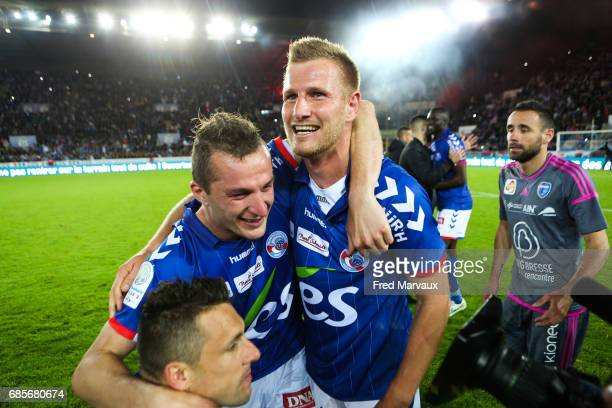 Jeremy Grimm of Strasbourg and Strasbourg celebrates accesion for Ligue 1 at the end of the game during the Ligue 2 match between RC Strasbourg...