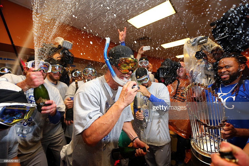 Jeremy Guthrie #11 of the Kansas City Royals celebrates with teammates in the clubhouse after defeating the New York Mets to win Game Five of the 2015 World Series at Citi Field on November 1, 2015 in the Flushing neighborhood of the Queens borough of New York City. The Kansas City Royals defeated the New York Mets with a score of 7 to 2 to win the World Series.