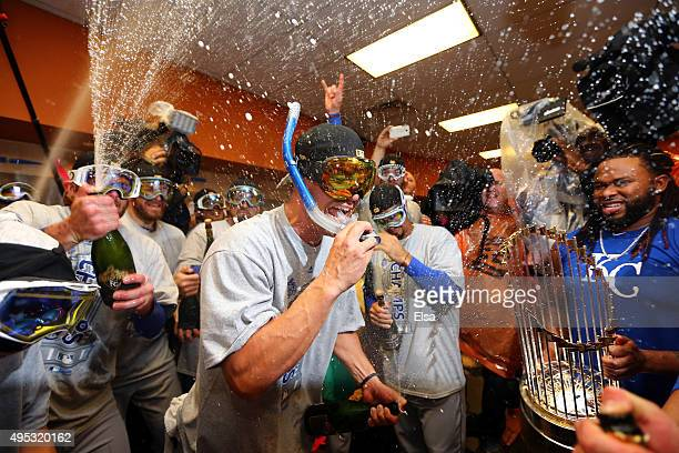 Jeremy Guthrie of the Kansas City Royals celebrates with teammates in the clubhouse after defeating the New York Mets to win Game Five of the 2015...