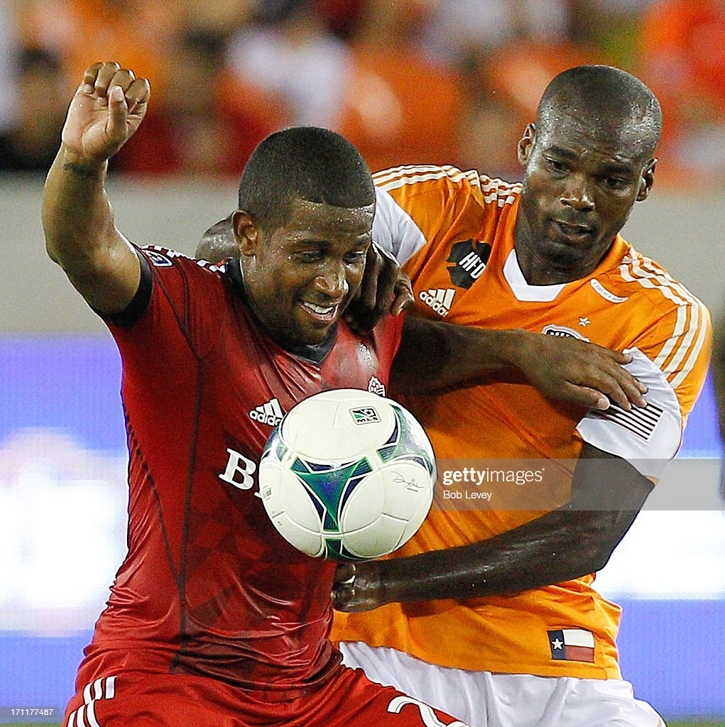 Jeremy Hall #25 of Toronto FC and Omar Cummings #7 of Houston Dynamo battle for the ball in the second half at BBVA Compass Stadium on June 22, 2013 in Houston, Texas.