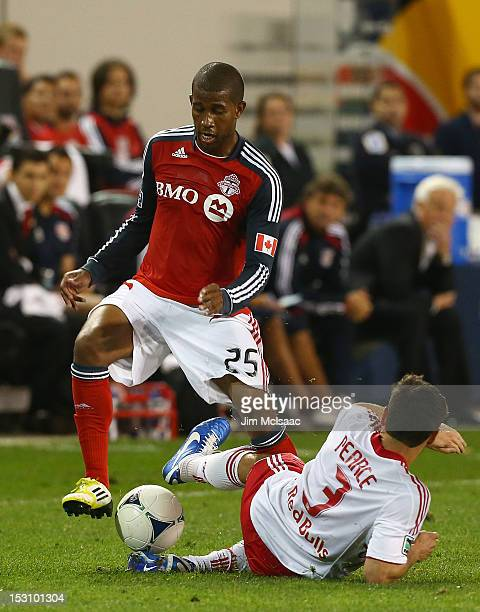 Jeremy Hall of Toronto FC tries to control the ball against Heath Pearce of the New York Red Bulls at Red Bull Arena on September 29, 2012 in...