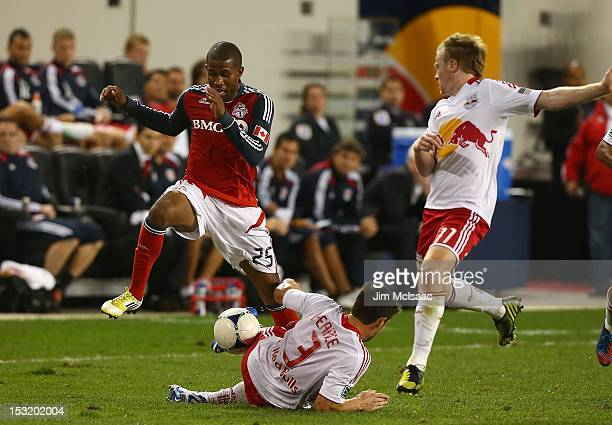 Jeremy Hall of Toronto FC tries to control the ball against Heath Pearce and Dax McCarty of the New York Red Bulls at Red Bull Arena on September 29,...