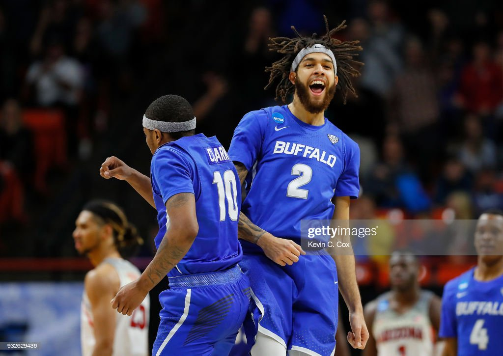 Jeremy Harris #2 celebrates with Wes Clark #10 of the Buffalo Bulls in the second half against the Arizona Wildcats during the first round of the 2018 NCAA Men's Basketball Tournament at Taco Bell Arena on March 15, 2018 in Boise, Idaho.