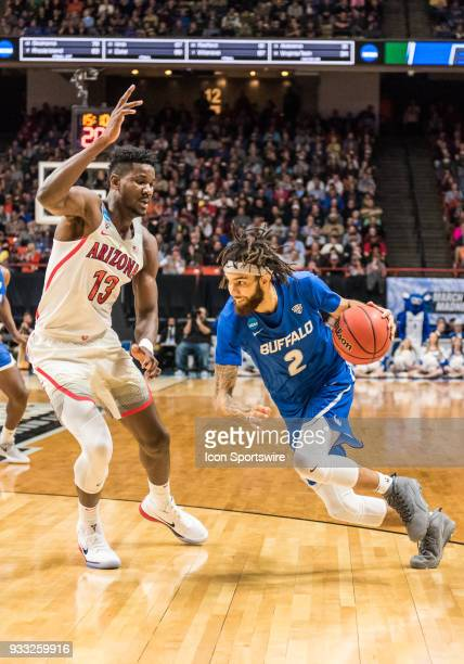 Jeremy Harris of the Buffalo Bulls moves around F DeAndre Ayton of the Arizona Wildcats during the NCAA Division I Men's Championship First Round...