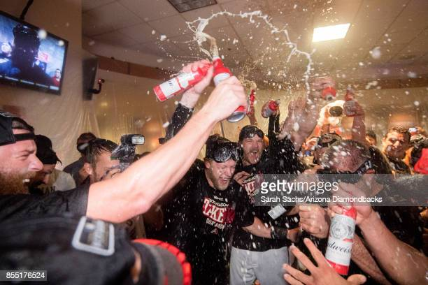 Jeremy Hazelbaker and Andrew Chafin of the Arizona Diamondbacks celebrate in the locker room after defeating the Miami Marlins and clinching a...