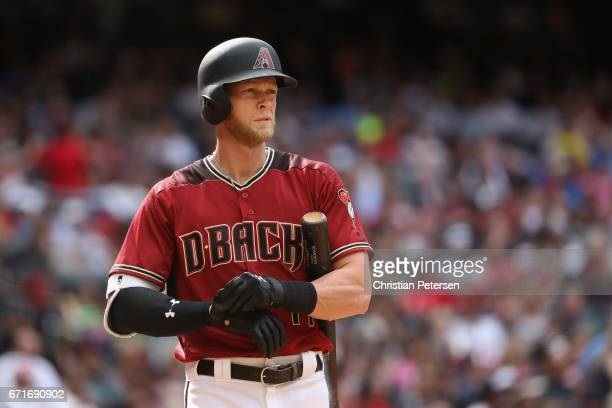 Jeremy Hazelbaker of the Arizona Diamondbacks adjusts his batting gloves during the MLB game against the Cleveland Indians at Chase Field on April 9...