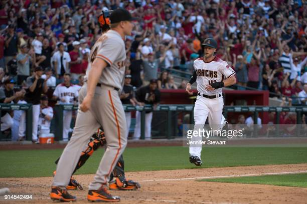 Jeremy Hazelbaker of the Arizona Diamondbacks safely scores in front of Mark Melancon of the San Francisco Giants in the ninth inning at Chase Field...
