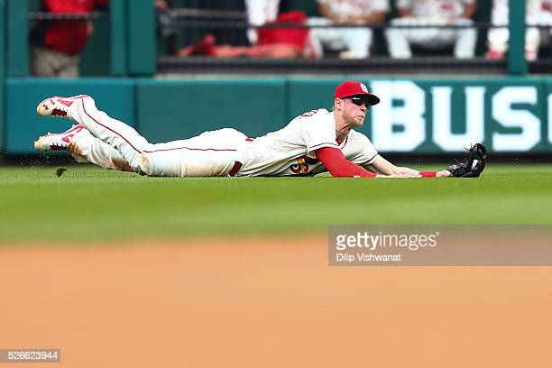 Jeremy Hazelbaker of the St Louis Cardinals catch a line drive against the Washington Nationals in the eighth inning at Busch Stadium on April 30...