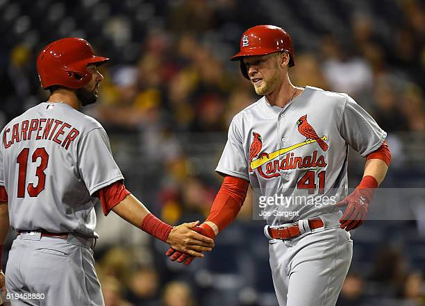 Jeremy Hazelbaker of the St Louis Cardinals celebrates his first career home run with Matt Carpenter during the sixth inning against the Pittsburgh...