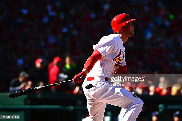 Jeremy Hazelbaker of the St Louis Cardinals hits a sacrifice fly in the second inning against the Milwaukee Brewers during the home opener at Busch...