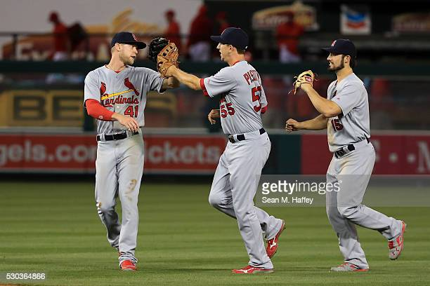 Jeremy Hazelbaker Stephen Piscotty and Randal Grichuk of the St Louis Cardinals congratlate each other after a baseball game between the Los Angeles...