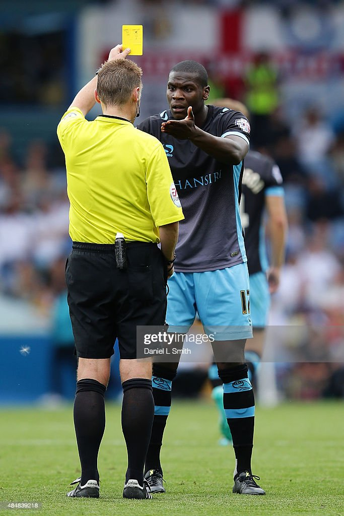 Jeremy Helan of Sheffield Wednesday FC reacts to the referee after receiving a yellow card during the Sky Bet Championship match between Leeds United and Sheffield Wednesday at Elland Road on August 22, 2015 in Leeds, England.