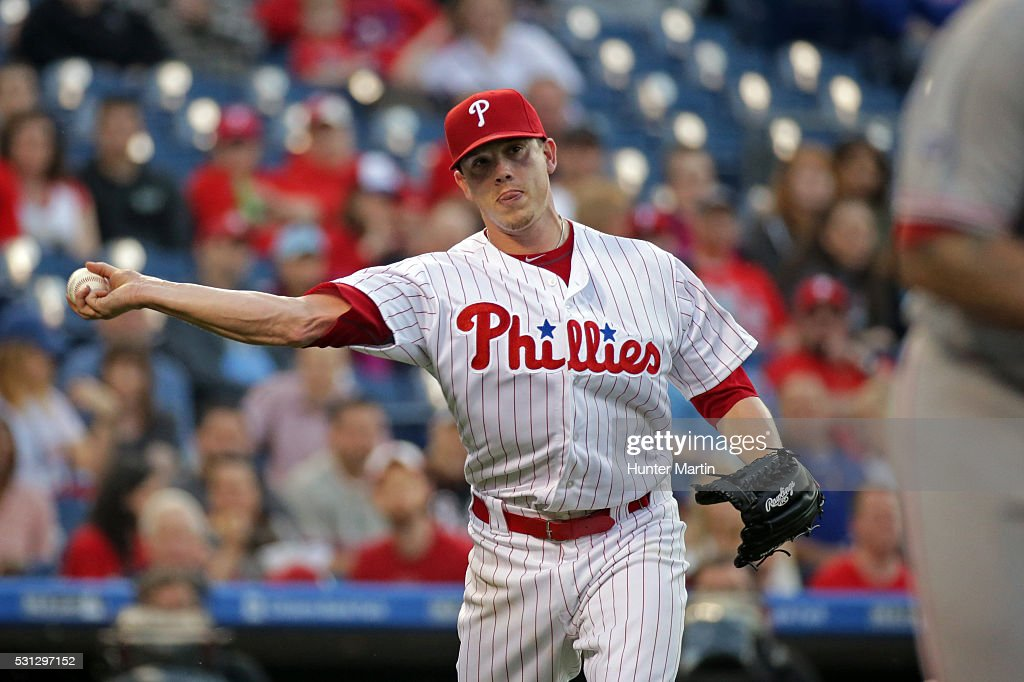 Jeremy Hellickson #58 of the Philadelphia Phillies throws to first base after fielding a ground ball in the second inning during a game against the Cincinnati Reds at Citizens Bank Park on May 13, 2016 in Philadelphia, Pennsylvania. The Phillies won 3-2.