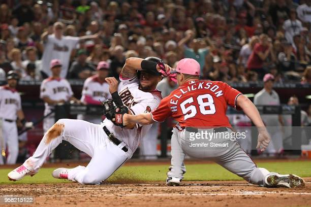 Jeremy Hellickson of the Washington Nationals tags out David Peralta of the Arizona Diamondbacks at home plate in the third inning of the MLB game at...