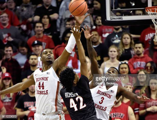 Jeremy Hemsley of the San Diego State Aztecs shoots against Brandon McCoy and Amauri Hardy of the UNLV Rebels during a game at the Thomas Mack Center...