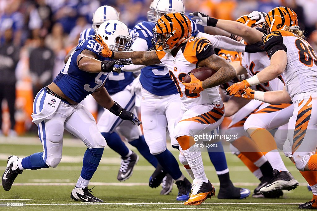 Jeremy Hill #32 of the Cincinnati Bengals carries the ball against the Indianapolis Colts in the second half during their AFC Wild Card game at Lucas Oil Stadium on January 4, 2015 in Indianapolis, Indiana.