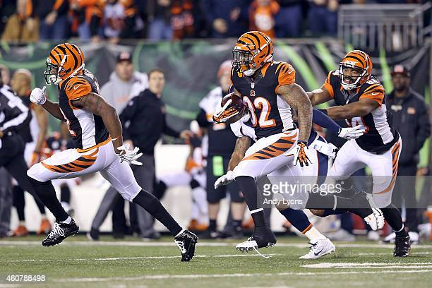 Jeremy Hill of the Cincinnati Bengals carries the ball for an 85 yard touchdown run during the first quarter of the game against the Denver Broncos...