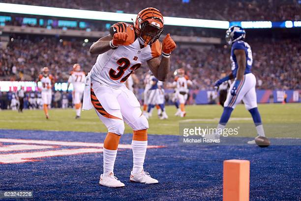 Jeremy Hill of the Cincinnati Bengals celebrates after scoring a 9 yard touchdown against the New York Giants during the third quarter of the game at...