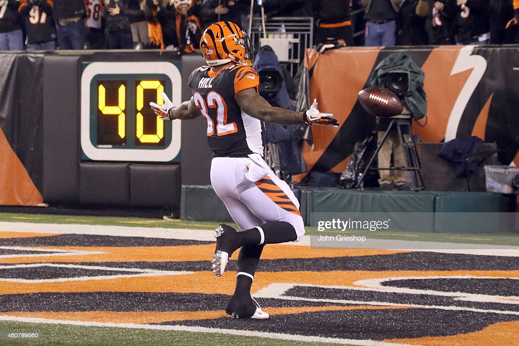 Jeremy Hill #32 of the Cincinnati Bengals celebrates after scoring a touchdown on an 85 yard run during the first quarter of the game against the Denver Broncos at Paul Brown Stadium on December 22, 2014 in Cincinnati, Ohio.