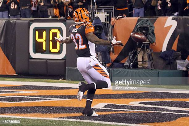 Jeremy Hill of the Cincinnati Bengals celebrates after scoring a touchdown on an 85 yard run during the first quarter of the game against the Denver...