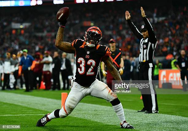 Jeremy Hill of the Cincinnati Bengals celebrates after scoring a touchdown during the NFL International Series Game between Washington Redskins and...