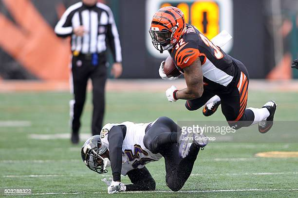Jeremy Hill of the Cincinnati Bengals is tackled by Shareece Wright of the Baltimore Ravens during the fourth quarter at Paul Brown Stadium on...