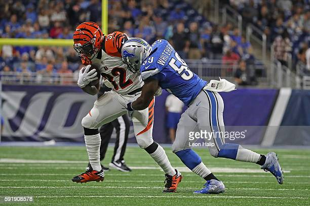 Jeremy Hill of the Cincinnati Bengals makes the catch for a short gain as Tahir Whitehead of the Detroit Lions makes the stop during the first...