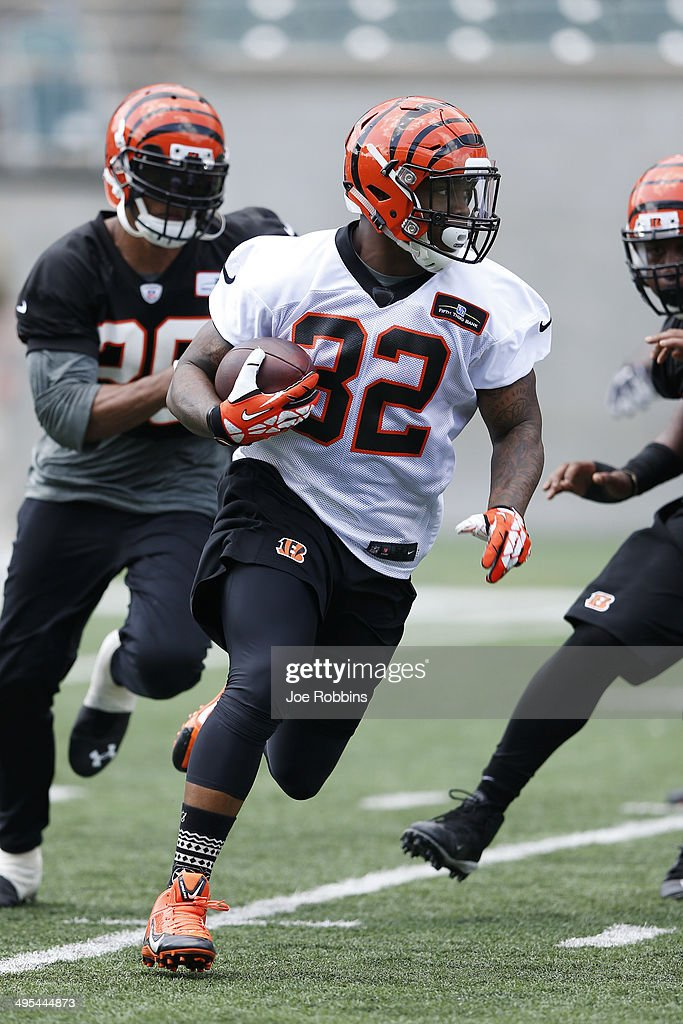 Jeremy Hill #32 of the Cincinnati Bengals runs the ball during an organized team activity (OTA) workout at Paul Brown Stadium on June 3, 2014 in Cincinnati, Ohio.