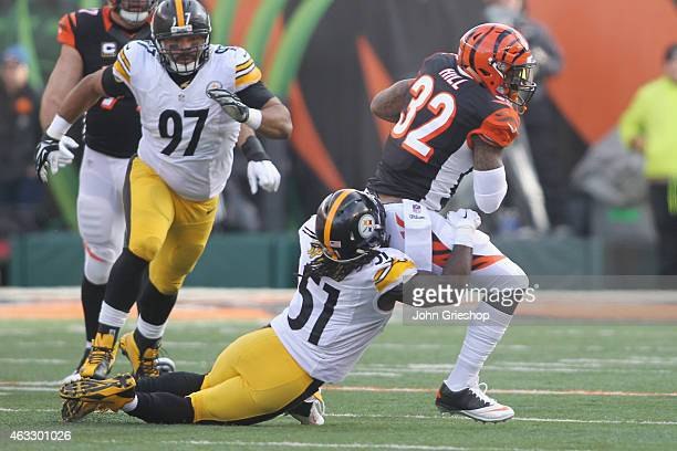 Jeremy Hill of the Cincinnati Bengals runs the football upfield against Sean Spence of the Pittsburgh Steelers during their game at Paul Brown...