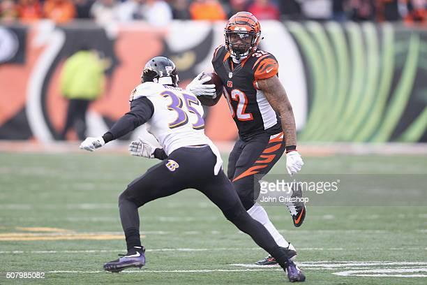 Jeremy Hill of the Cincinnati Bengals rushes the football upfield against Shareece Wright of the Baltimore Ravens during their game at Paul Brown...