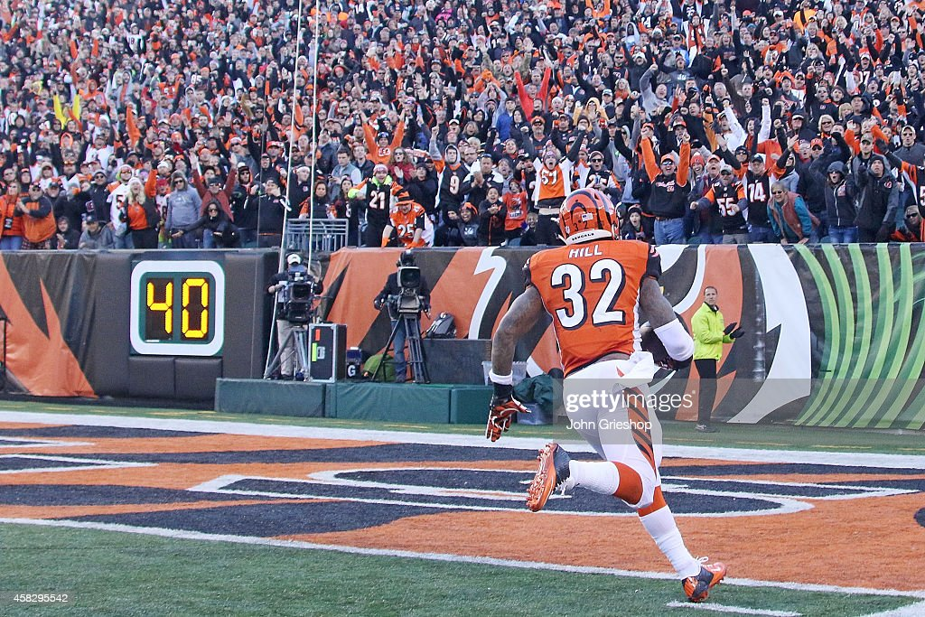 Jeremy Hill #32 of the Cincinnati Bengals scores a touchdown on a 60 yard run during the fourth quarter of the game against the Jacksonville Jaguars at Paul Brown Stadium on November 2, 2014 in Cincinnati, Ohio. Cincinnati defeated Jacksonville 33-23.
