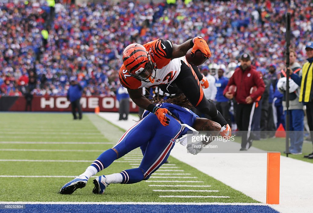 Jeremy Hill #32 of the Cincinnati Bengals scores a touchdown over the defensive effort of Stephon Gilmore #24 of the Buffalo Bills during the first half at Ralph Wilson Stadium on October 18, 2015 in Orchard Park, New York.