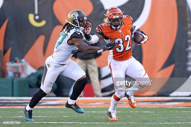 Jeremy Hill of the Cincinnati Bengals stiff arms Tommie Campbell of the Jacksonville Jaguars during the third quarter at Paul Brown Stadium on...
