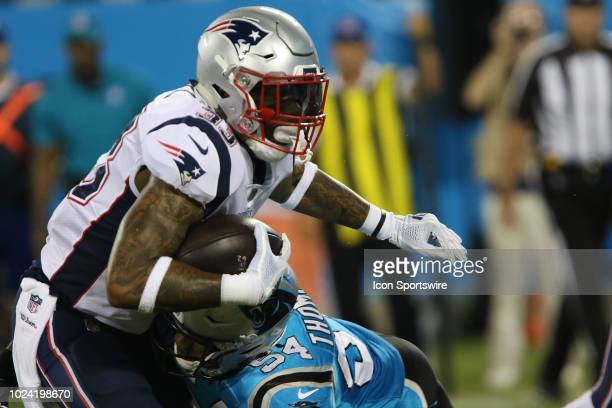 Jeremy Hill of the Patriots is tackled by Shaq Thompson linebacker Carolina Panthers during the New England Patriots Carolina Panthers football game...