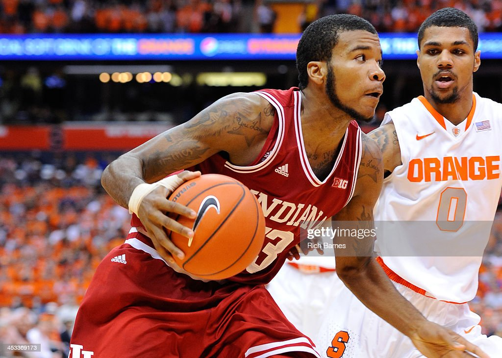Jeremy Hollowell #33 of the Indiana Hoosiers drives to the basket past Michael Gbinije #0 of the Syracuse Orange during the second half at the Carrier Dome on December 3, 2013 in Syracuse, New York. Syracuse defeated Indiana 69-52.