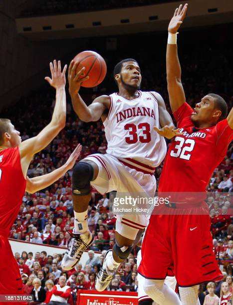 Jeremy Hollowell of the Indiana Hoosiers splits the defense of Connor Miller and Tim Williams of the Samford Bulldogs at Assembly Hall on November 15...