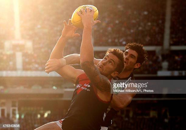 Jeremy Howe of the Demons and Tyson Goldsack of the Magpies compete for the ball during the 2015 AFL round ten match between the Melbourne Demons and...