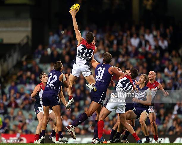 Jeremy Howe of the Demons competes in the ruck against Aaron Sandilands of the Dockers during the round 23 AFL match between the Fremantle Dockers...